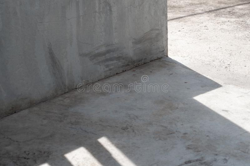 Abstract white concrete wall fragment and floor. Corner with shadow texture stock images