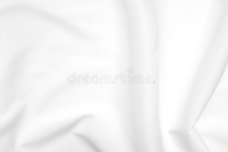 Abstract white fabric texture background. Cloth soft wave. Creases of satin, silk, and cotton. royalty free stock photos