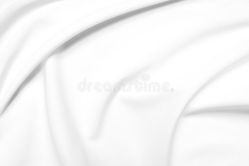 Abstract white fabric texture background. Cloth soft wave. Creases of satin, silk, and cotton. royalty free stock photography