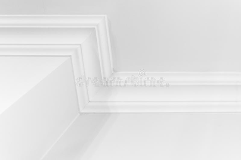 Abstract white interior fragment, ceiling baseboard. Abstract white interior fragment with walls and decorative ceiling baseboard stock photography