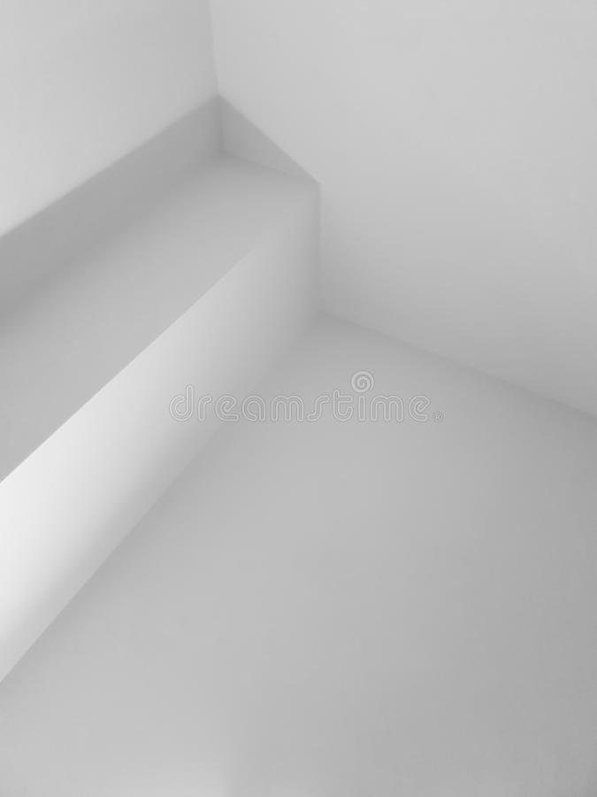 Abstract white interior photo with corners. Background, architecture, geometric, clean, building, design, black, decoration, simple, modern, architectural royalty free stock image