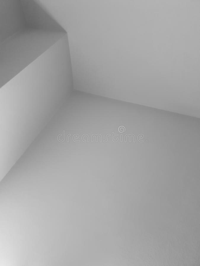 Abstract white interior photo with corners. Background, architecture, geometric, clean, building, design, black, decoration, simple, modern, architectural royalty free stock images