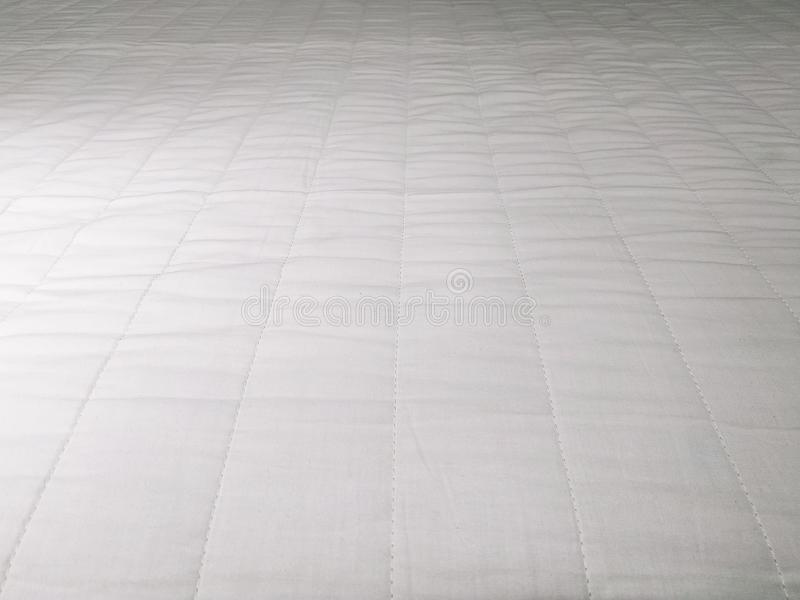 Abstract white mattress bedding texture background close up stock photography
