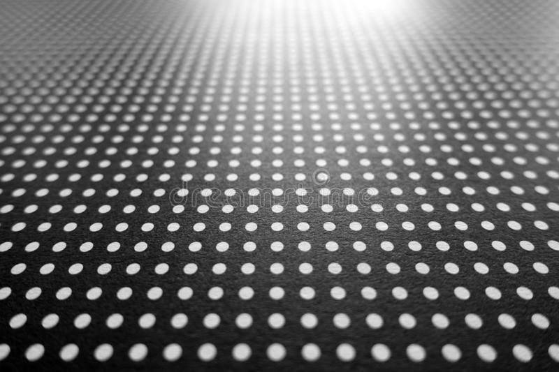 Abstract White Polka Dots on a Black Background. With Horizon and Light in the Distance stock image