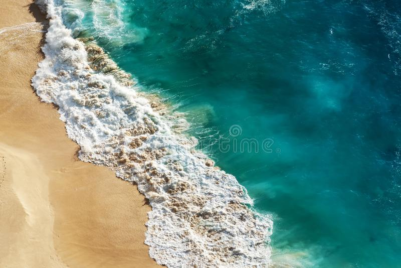 Abstract white sand beach with turquoise tropical sea water. Aerial drone shot. Kelingking Beach in Nusa Penida Bali, Indonesia stock image
