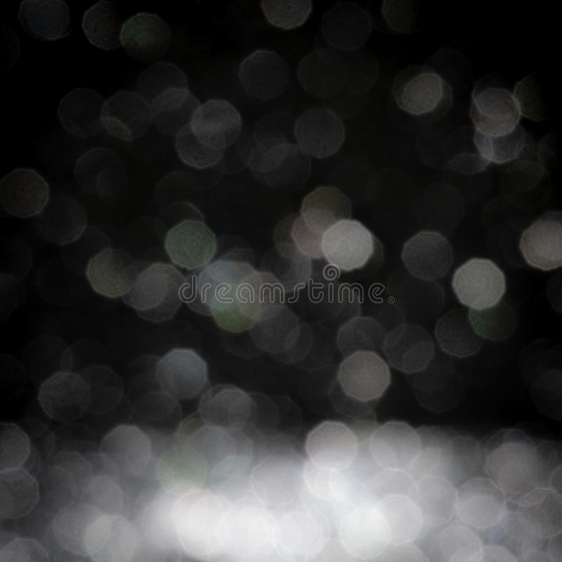 Abstract white silver glitter bokeh defocused texture background on black stock photo