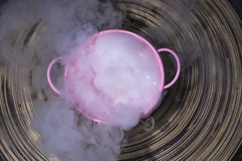 Abstract white smoke from dry ice in the pinky bowl royalty free stock images