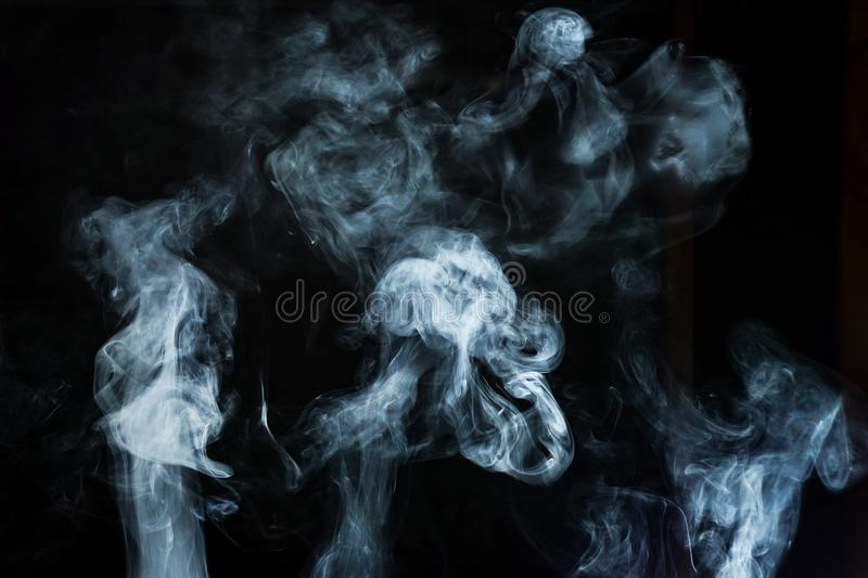 Abstract white smoke effect isolated on black. Background royalty free stock images
