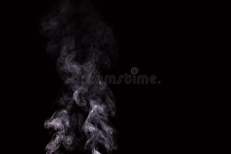 Abstract white water vapor on a black background stock image