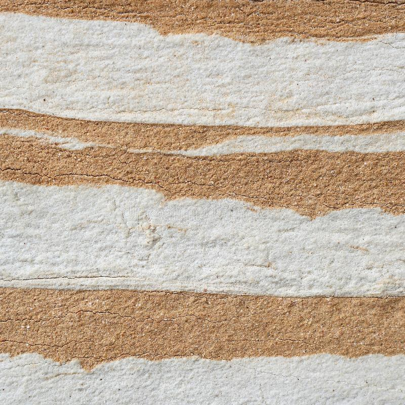 Abstract white-yellow layers stone wall texture stock image