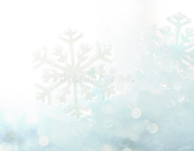Abstract winter blue bokeh snowflake background royalty free stock photo