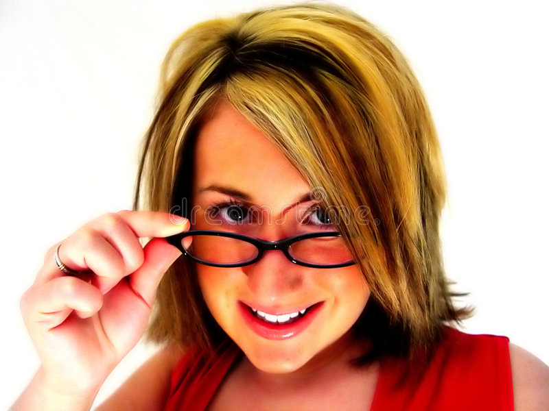 Abstract - Woman looking over glasses stock images