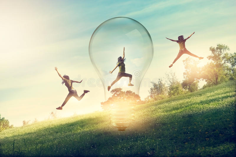 Abstract woman running and jumping for catching lightbulb on nature background royalty free stock images