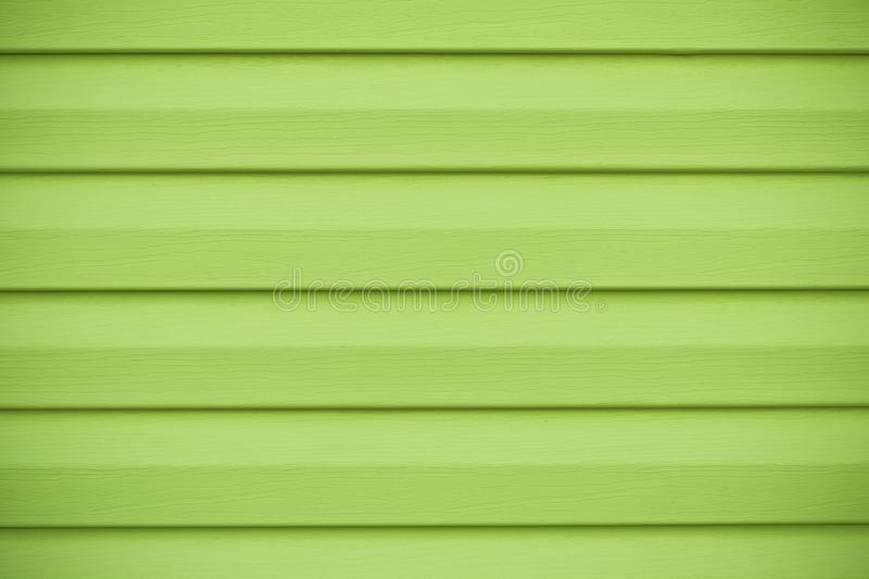Abstract wood plank background. Green wooden texture in horizontal stripes. Board of lime color, yellow wall in lines, bright surf royalty free stock image