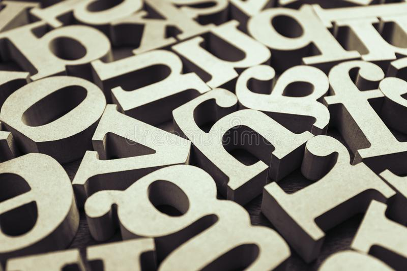 Abstract Wooden Alphabet. Abstract wooden English alphabet scattered on the table stock images