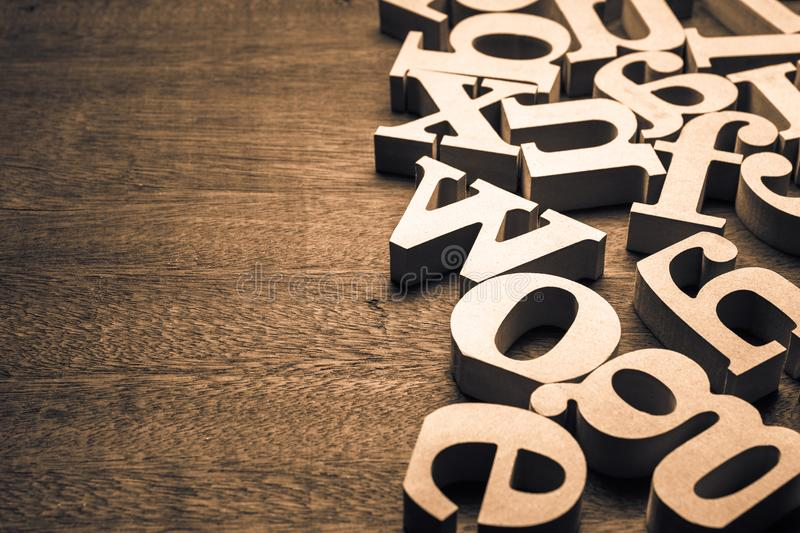 Abstract Wooden Alphabet. Abstract wooden English alphabet scattered on the table stock photo