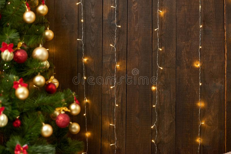 Abstract wooden background with christmas tree and lights, classic dark interior backdrop, copy space for text, winter holiday con royalty free stock photos