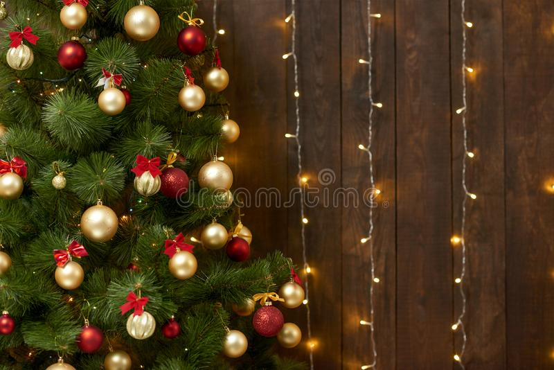 Abstract wooden background with christmas tree and lights, classic dark interior backdrop, copy space for text, winter holiday con stock images