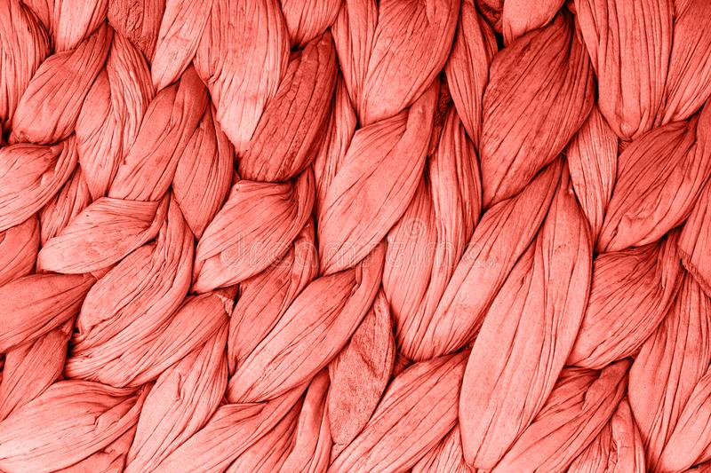Abstract woven mat texture background living coral color. stock photo