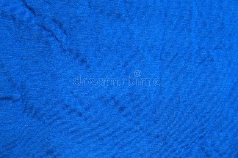 Abstract wrinkled blue textile background or texture stock image