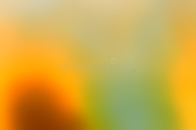 Abstract in yeallow and green. Bright abstract background in rich gold, yellow and green tones of blurred light