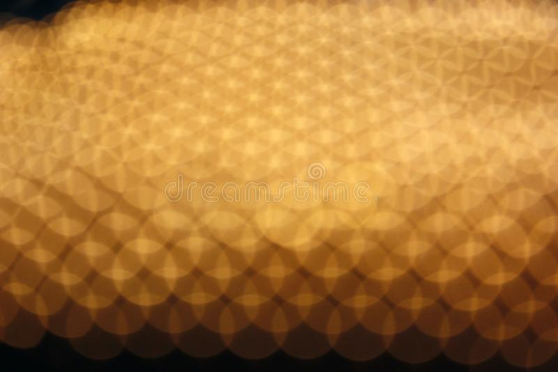 Abstract yellow bokeh defocused background. Colored lights blur gold balls background royalty free stock photos