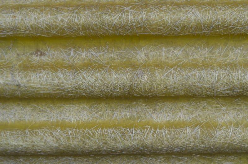 Fiberglass texture. Abstract yellow corrugated fiberglass texture stock images