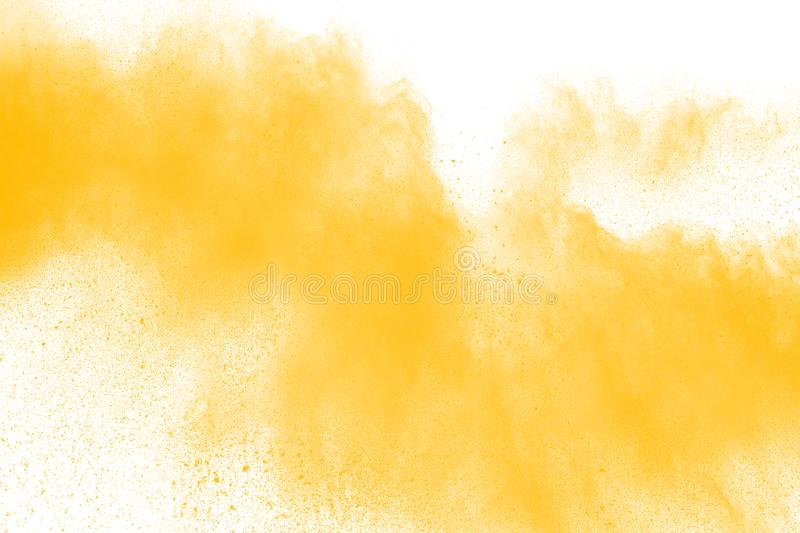 Abstract yellow powder splattered on white background. Powder explosion. Abstract yellow dust explosion. abstract yellow powder splattered on white background royalty free stock image