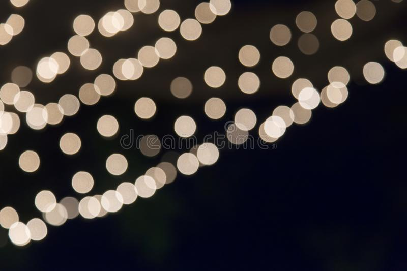 \Abstract yellow  light Bokeh background with copy space black backdrop stock images