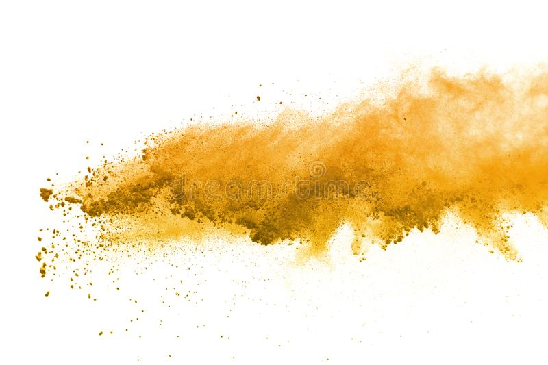 Abstract of yellow powder explosion on white background. Yellow powder splatted isolate. Colored cloud. Colored dust explode. Pain stock images