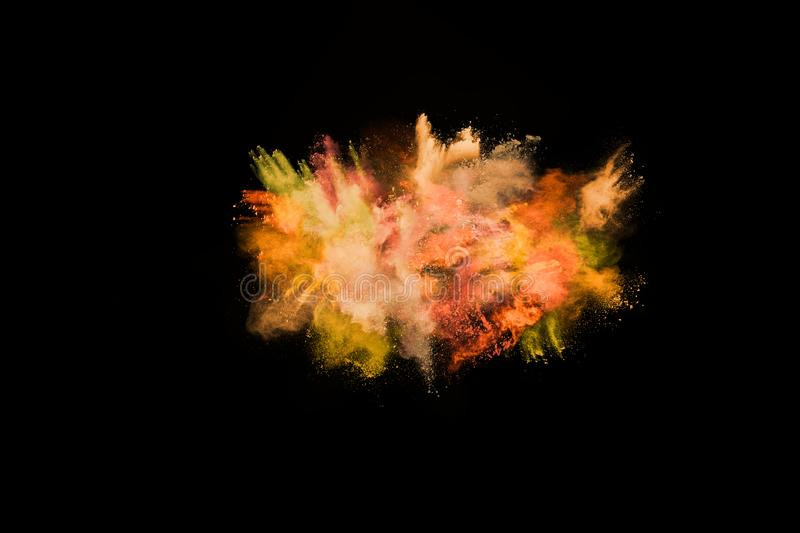 Yellow color powder explosion on black background. Abstract yellow powder splatted background,Freeze motion of color powder exploding/throwing color powder,color stock photo