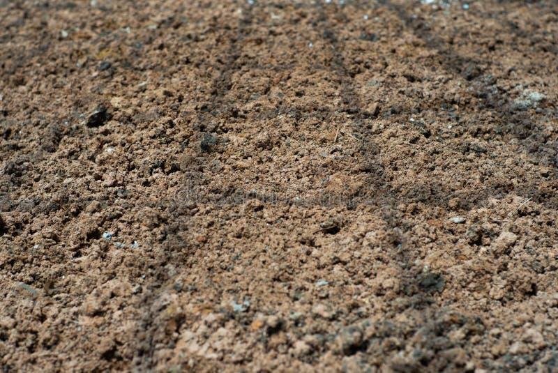 Abstracte achtergrond en textuur van lateritic grond met de elft royalty-vrije stock afbeelding