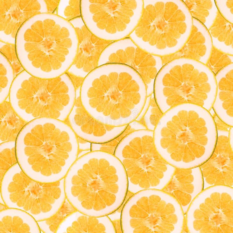 Abstracte achtergrond met plakken van verse grapefruit Naadloos patroon voor ontwerp Close-up De fotografie van de studio stock afbeelding