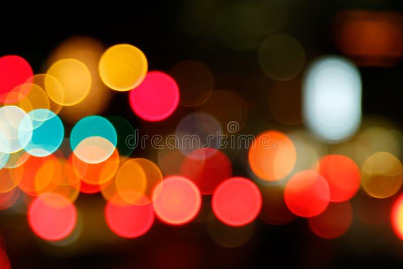 Abstracte achtergrond van de lichten van de bokehstad stock foto