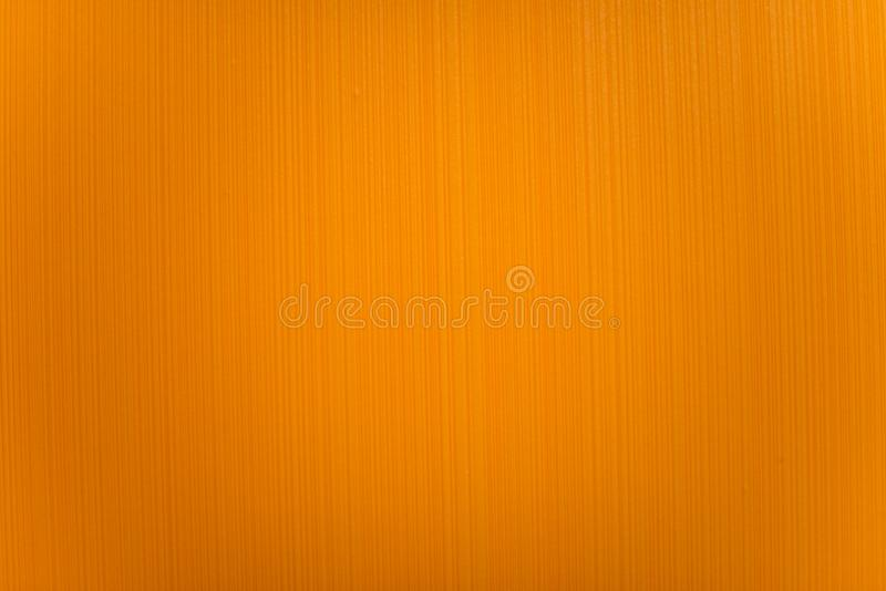 Abstracte achtergrond van geel plastiek, textuur stock foto's