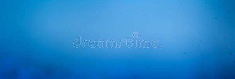 Abstracte blauwe achtergrond, exemplaarruimte, affiche voor uw ontwerp royalty-vrije stock foto
