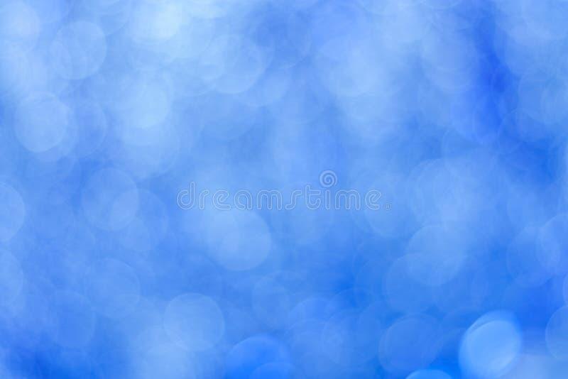 Abstracte blauwe bokehachtergrond Cirkellichten van vaag klatergoud stock afbeeldingen