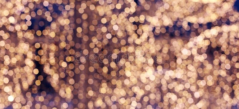 Abstracte bokehachtergrond De Schitterende achtergrond van Kerstmis Warmte, behaaglijkheid Vage achtergrond met bookeh royalty-vrije stock foto's