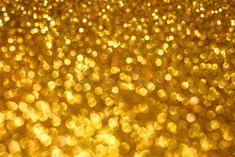 Abstracte bokehachtergrond van de Kerstmisvakantie met gouden lichten Schitter bokeh achtergrond royalty-vrije stock afbeelding
