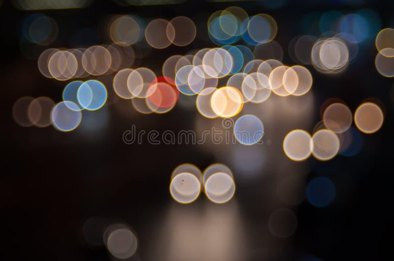 Abstracte cirkelbokehachtergrond royalty-vrije stock afbeeldingen