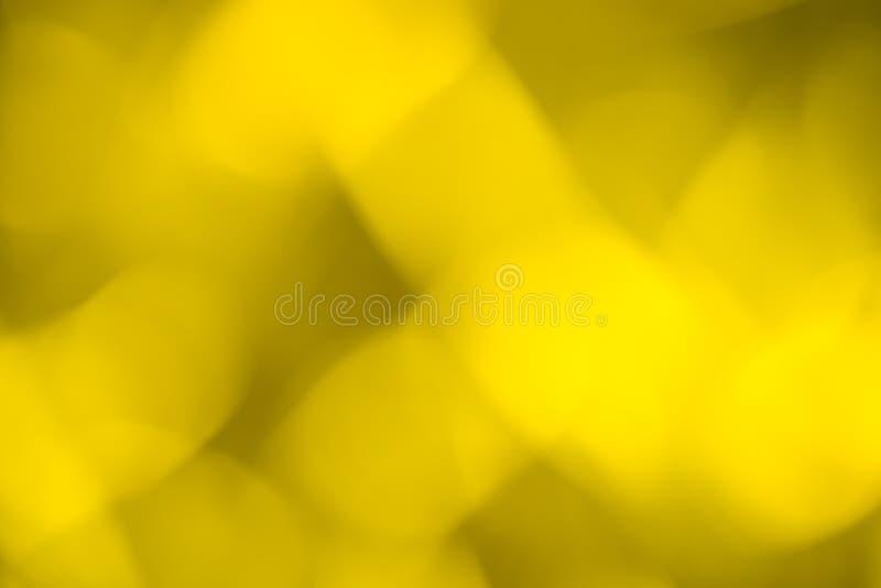 Abstracte gele bokehachtergrond met ovale lijnen royalty-vrije stock foto's
