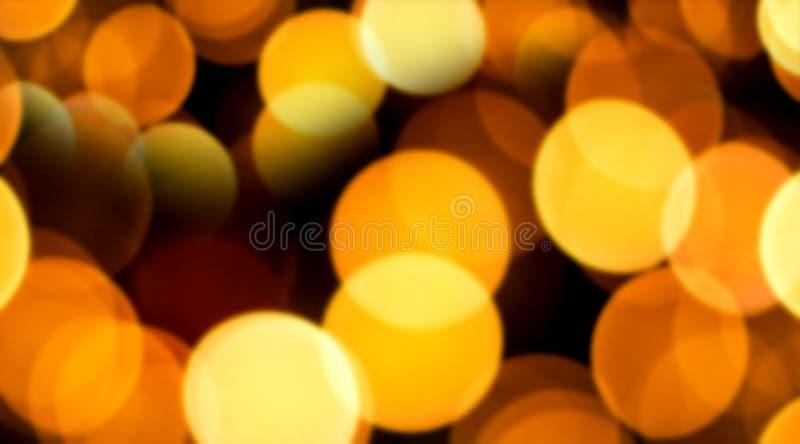 Abstracte gouden gele bokeh backgrond Gloed vage lichten, de ontwerpsjabloon van de Kerstmisdecoratie stock foto's