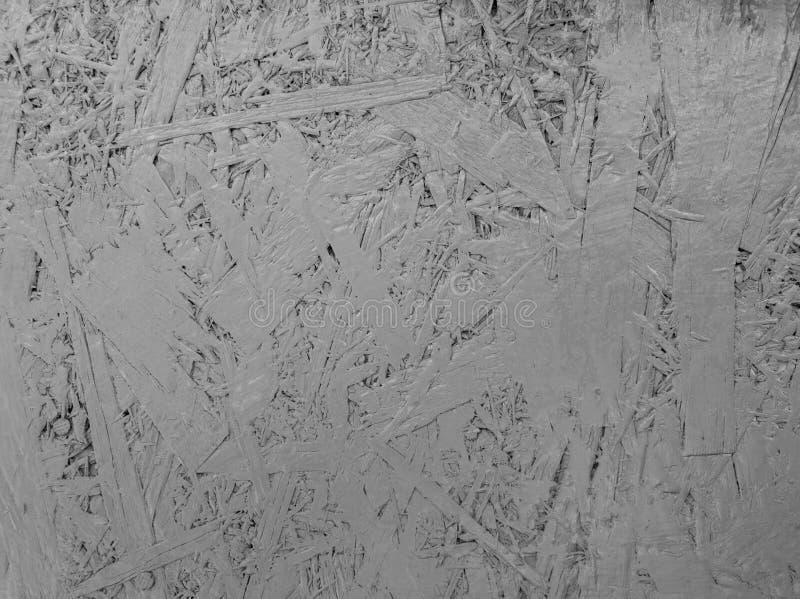 Abstracte grijze kleur geschilderde georiënteerde bundelraad De textuurachtergrond van het Grungetriplex stock foto