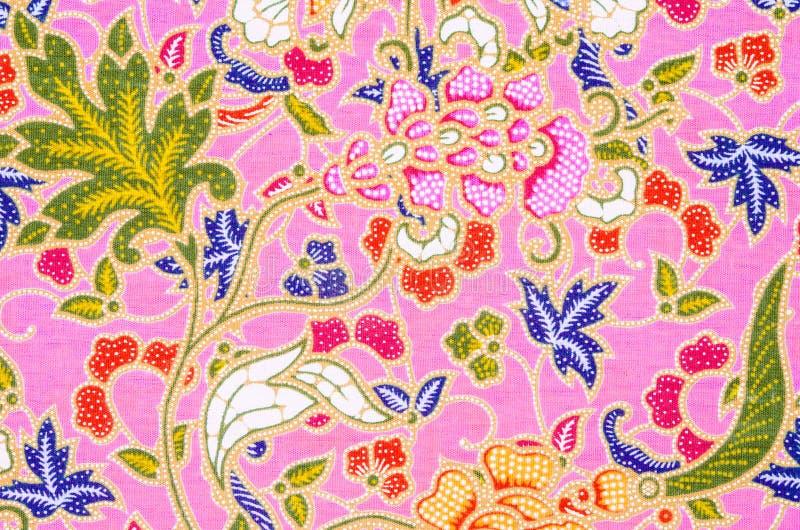 Abstracte heldere textiel in batik royalty-vrije stock afbeeldingen