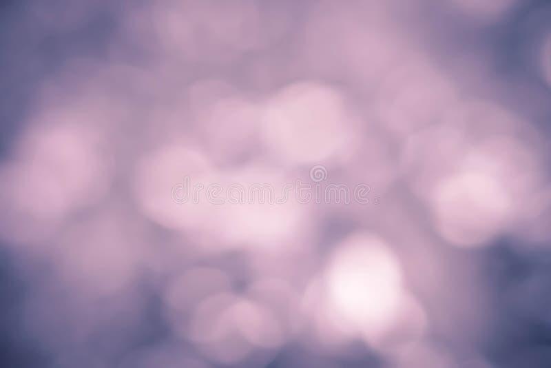 Abstracte Kerstmis fonkelde heldere achtergrond met bokehdefocu stock foto