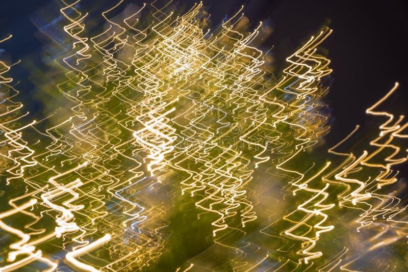 Abstracte Kerstmisachtergrond met het bewegen van feelichten royalty-vrije stock fotografie