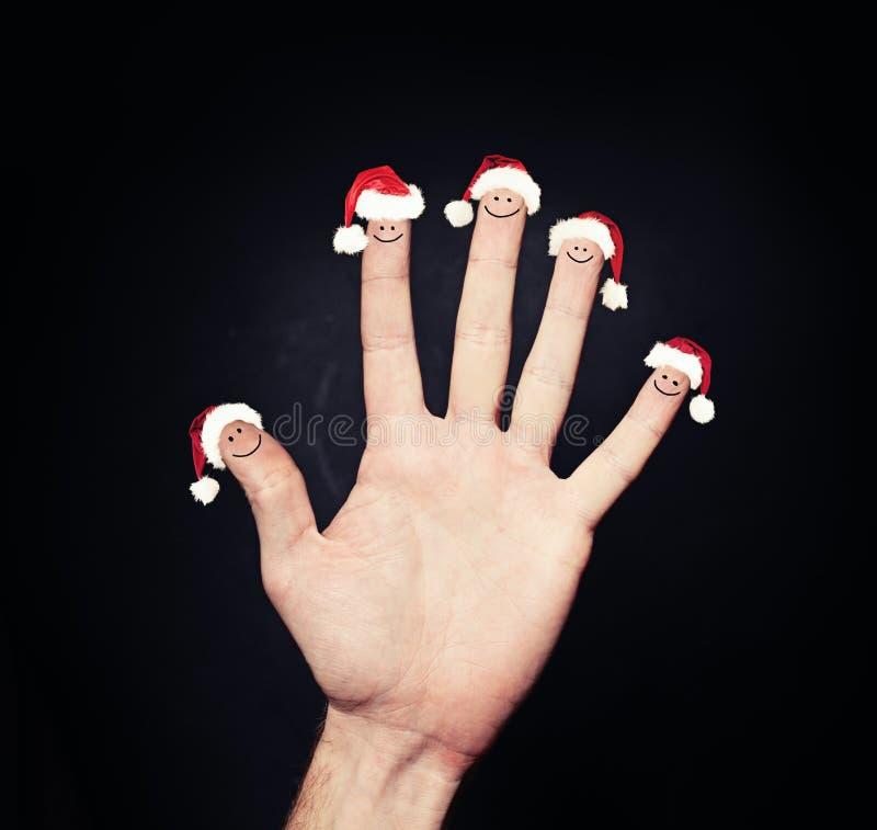 Abstracte Kerstmismensen Kerstmisvingers in Kerstmanhoed royalty-vrije stock foto