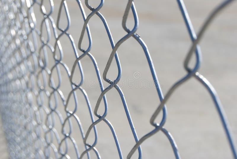 Abstracte kettingslink omheining stock afbeelding
