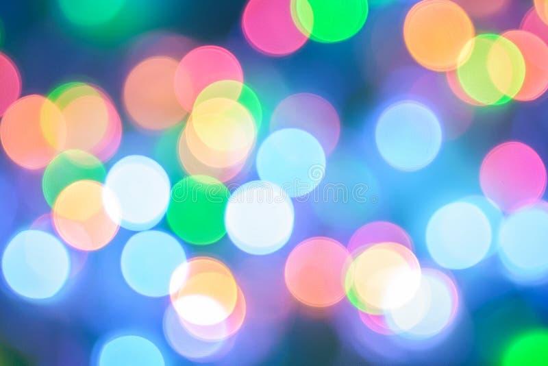 Abstracte kleurenachtergrond met licht Kerstmisnieuwjaar van het bokehonduidelijke beeld royalty-vrije stock foto