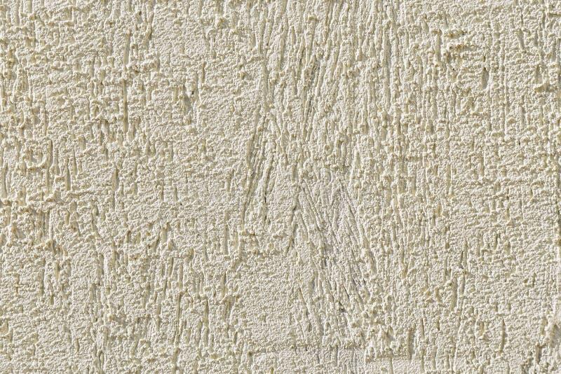 Abstracte lichte beige korrelige achtergrond met de textuur van coars stock afbeelding